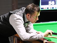 Dominic Dale playing a shot with a rest
