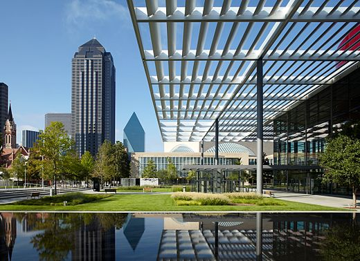 Pictured in the foreground is the Winspear Opera House with its reflecting pool and the Meyerson Symphony Center, both located within the Dallas Arts District. Downtown Dallas Arts District.jpg