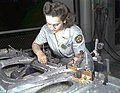 Drilling a wing bulkhead for a transport plane at the Consolidated Aircraft Corporation 1a34934v (cropped).jpg