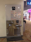 "Drinking water station at Changi Airport, Singapore with ""drinking water"" written in multiple languages.JPG"