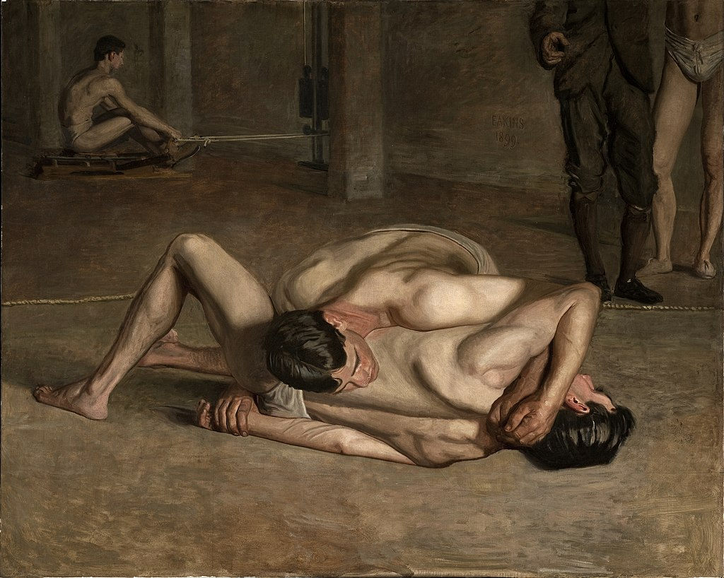 Two almost naked men wrestling or embracing each other