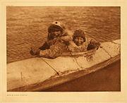 Boys in kayak, Nunivak, Alaska, photographed by Edward S. Curtis, 1930