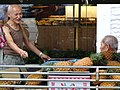 Elderly Men at Fruit Stall - Zhongzheng District - Taipei - Taiwan (32918406407).jpg