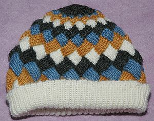 Hat knit using entrelac, in four colors