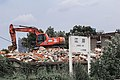 Excavator and the sign of Jiang'an Railway Station.jpg