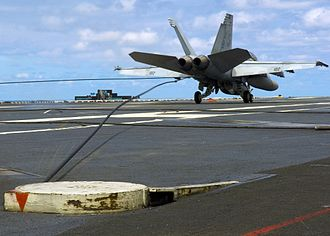 Tailhook - An FA-18 makes an arrested landing aboard a US aircraft carrier.