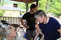FEMA - 41433 - FEMA public information officer with a resident in Perry County Kentucky.jpg