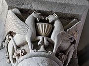 Facing griffins guard a chalice, on a 12th century capital from the abbey of Mozac in the Auvergne