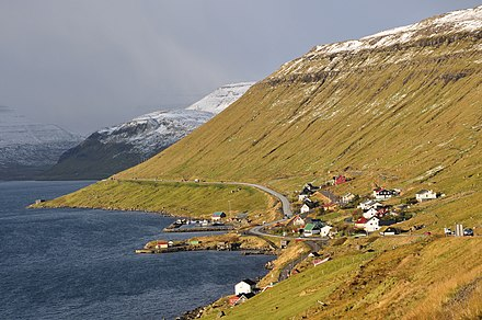 Skipanes on Eysturoy, with different weather in the distance Faroe Islands, Eysturoy, Skipanes and Undir Gotueidi.jpg