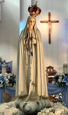 The pilgrim image of Our Lady of Fatima devoted by the Blue Army. Fatima Mary IC Sparks.jpg