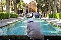 Fin Garden, Kashan, Iran باغ فین کاشان، ایران 05- یک طلبه در کنار حوض در حال عکاسی.jpg