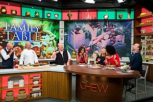 """The Chew - First Lady Michelle Obama tapes a segment of The Chew in New York on September 23, 2014. Participants with the First Lady from left are: Michael Symon, """"Let's Move!"""" Executive Director Sam Kass, Mario Batali, Daphne Oz, Carla Hall and Clinton Kelly."""