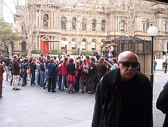 "Flash mob - Flash mobbing was quickly imitated outside of the United States. This picture is of ""sydmob"", the first flashmob held in Sydney, Australia"