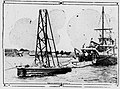 First salvaging submarine and the mother ship tube encloses stairway to submarine Simon Lake 1919.jpg