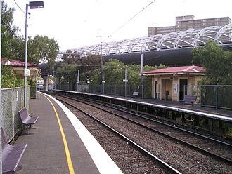 Upfield railway line - Flemington Bridge station, with CityLink in the background