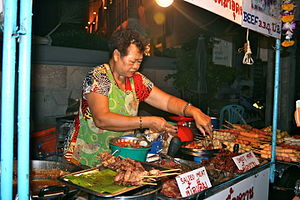 Street food of Thailand - A vendor selling various barbecued meat along a street in Bangkok.
