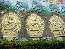 Four-faced buddhas with elephants.jpg