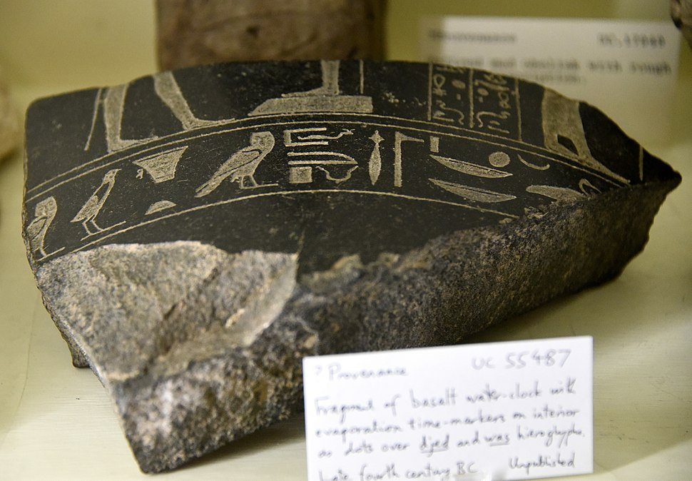 Fragment of a basalt water-clock with evaporation time markers on interior as dots on djed and was hieroglyphs. Late period, 30th Dynasty. From Egypt. The Petrie Museum of Egyptian Archaeology, London