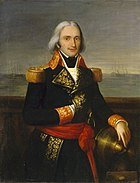 A man in an ornate naval uniform with long grey hair stands on a ship's quarterdeck.