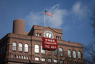Cooper Union financial crisis and tuition protests - Students hung a banner from the Cooper Union Foundation Building during a December 2012 occupation