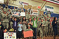 Friends and family cheer as U.S. Soldiers return home at the Special Events Center during the 438th Medical Detachment (Veterinary Services), 10th Combat Support Hospital redeployment ceremony March 21, 2013 at 130321-A-UK001-001.jpg