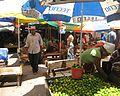 Fruit and vegetable stands in Kariakoo market.JPG