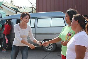 Gwendolyn Garcia - Rep. Garcia talks with a resident from northern Cebu, which was devastated by Typhoon Yolanda.