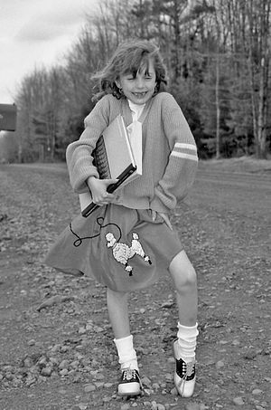 Saddle shoe - Girl wearing saddle shoes and a poodle skirt, 1961