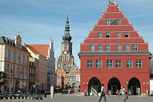 Greifswald - City hall and St. Nikolai cathedral at the central market square of Greifswald.