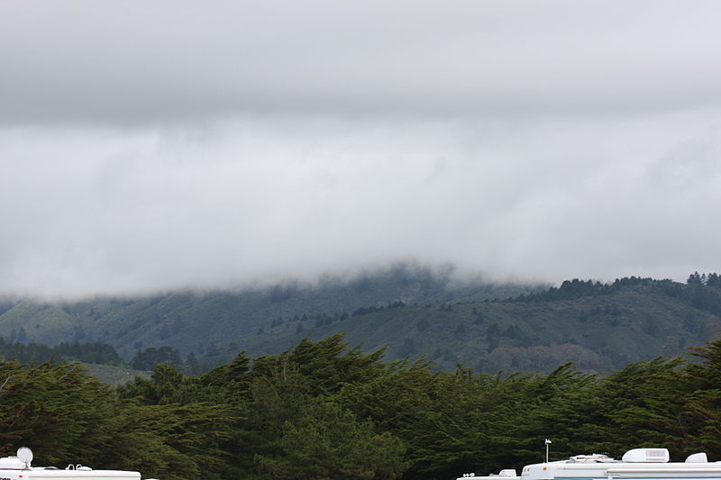 File:Half Moon Bay foggy mountains at beach.jpg