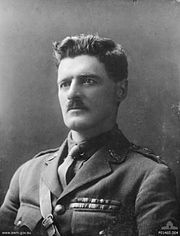 A head and shoulders portrait of a man in military uniform.