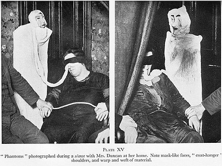 Helen Duncan (age 30) in a seance with dolls (1928). Helen Duncan fake ectoplasm.jpg