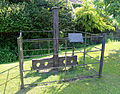 Hellmans Cross, Great Canfield, Essex, England - stocks and whipping post.JPG