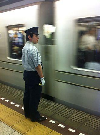 Tokyo Metro Hibiya Line - A Tokyo Metro station staff member on the Hibiya Line, October 2014