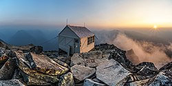 Hidden Peak Fire Lookout at sunset, with smokey haze from nearby fires.jpg
