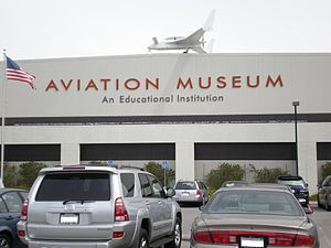 Hiller Aviation Museum - The front of the Hiller Aviation Museum.  A Rutan Long-EZ is on the roof.