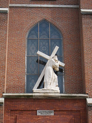 Holy Cross Church, Rectory and School - Statue of Christ on the Via Dolorosa on the church exterior