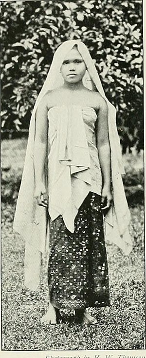 Kelantanese Malay people - Wearing a Kelantanese style sarong with a typical kain lepas girt about the breast.