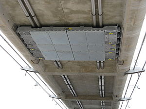 Infinity Bridge - Single tuned mass damper fitted to the underside of the concrete decking of the smaller arch of the bridge.