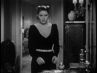 Notorious (1946 film) - Alicia takes the wine cellar key while Sebastian dresses for the party. The gown is by Edith Head.