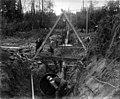 Installing pipe in trench underneath the Black River, ca 1899 (SPWS 409).jpg