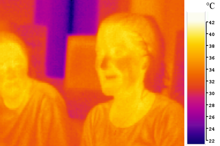 A pseudocolor image of two people taken in long-wavelength infrared (body-temperature thermal) light. Ir girl.png