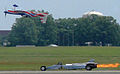 Jet dragster racing an inverted plane.jpg