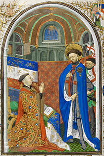 A 15th century man prays in front of a Christian saint