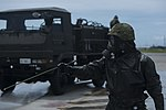 Joint forces decontaminate the flight line 071317-M-PY134-303.jpg