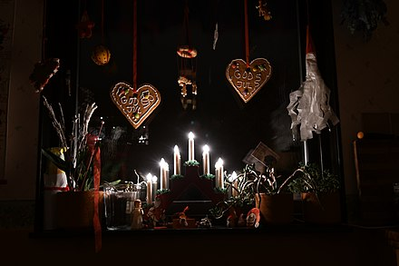 Advent lights and Christmas decorations in a Swedish window. Juldekorationer 2018 02.jpg