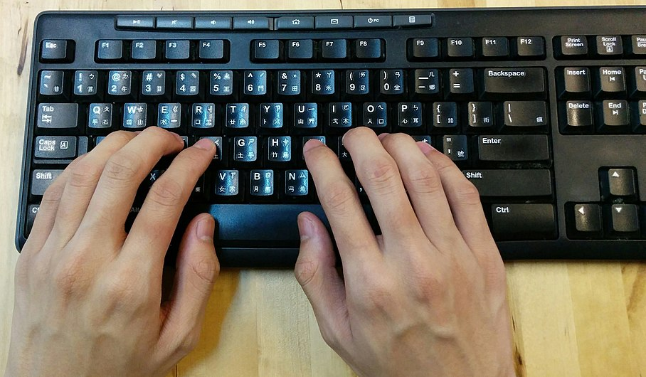Keyboard with fingers.jpg