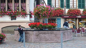Kintzheim - Kintzheim: In earlier centuries the village fountain would have been a meeting point for villagers, but during the twentieth century the arrival of a piped water supply left the fountain playing a largely decorative role.