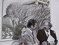 Klaus von Dohnanyi und Gattin im Gespräch mit Ernst Marow vor dessen Bild 'Am Rande des Sommers' anläßlich der 17. Ausstellung zeitgenössischer Kunst in der Villa Hammerschmidt Bonn 1973.jpg