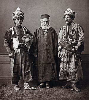 Pascal Sébah - Photo of two Kurdish men and a Catholic cleric, taken by Pascal Sebah at the universal exposition in Vienna, 1873.